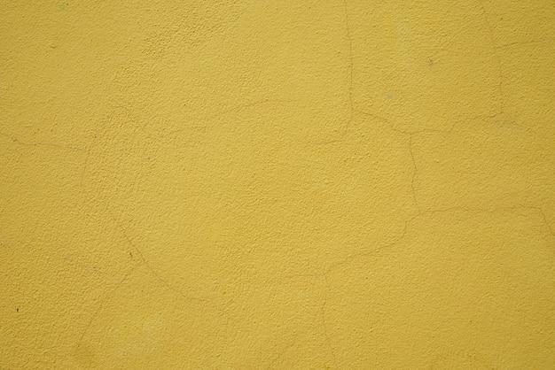 Amarelo texturizado da parede de cimento. abstrato. estilo vintage.