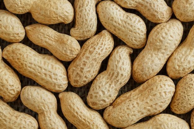 Amendoins em sua casca texturizado fundo de alimentos.