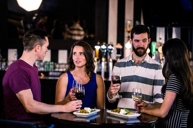 Amigos, tendo, um, vidro vinho, um bar