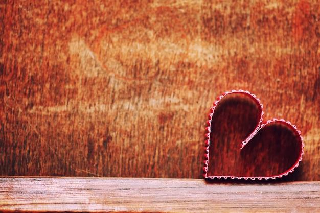 Amor em forma de coração de madeira de fundo