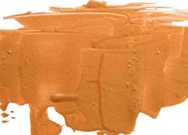Amostra de batom líquido dourado com brilhos, substância isolada no fundo branco, close-up