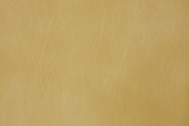 Amostra de couro bege texturizado artificial close up
