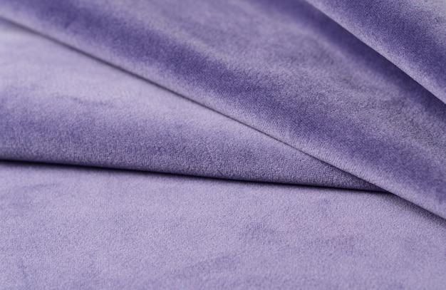 Amostra de matéria têxtil de veludo lilás brilhante. fundo de textura de tecido