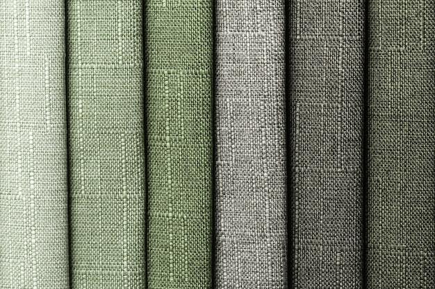 Amostra de tecido têxtil tom de cores verdes, plano de fundo. coleção de pano gradiente verde-oliva.