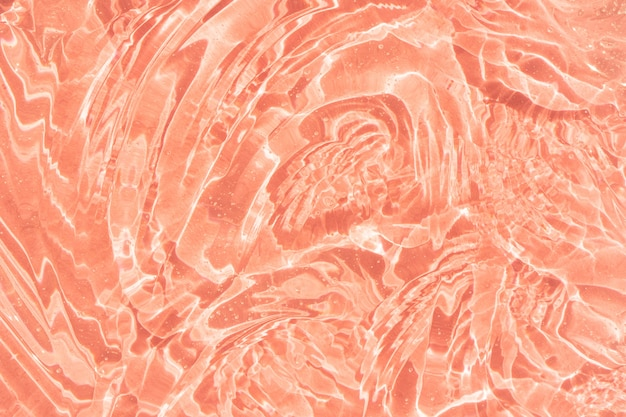 Amostra de textura de soro com colágeno e gel líquido transparente de peptídeos com bolhas de fundo rosa