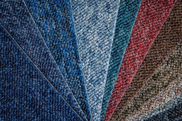 Amostras de carpetes multicoloridas em detalhes, plano de fundo e papel de parede