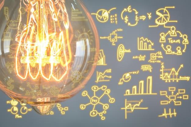 Ampola com diagramas do negócio fundo