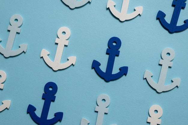 Âncoras azuis sobre um fundo azul. padrão.