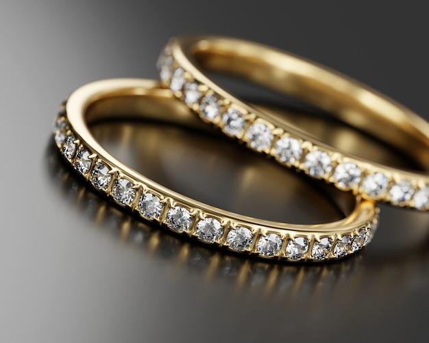 Anéis de diamante de ouro colocados em fundo brilhante macro foco objeto principal renderização em 3d