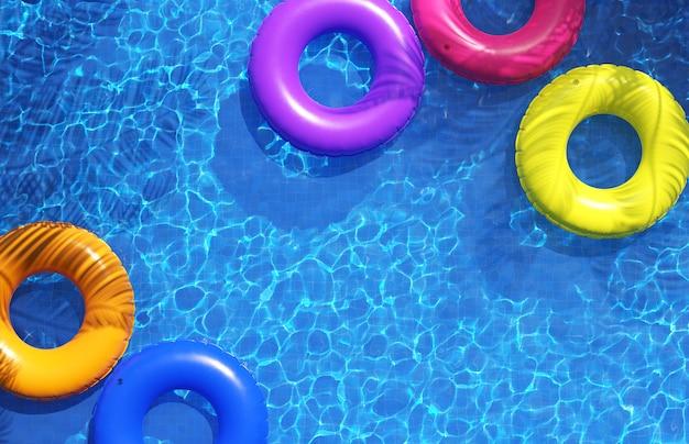 Anéis de natação multicoloridos na piscina