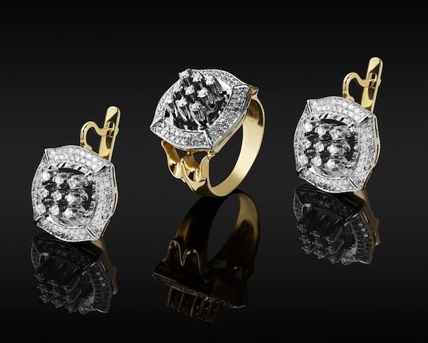 Anel de ouro e brincos com diamantes