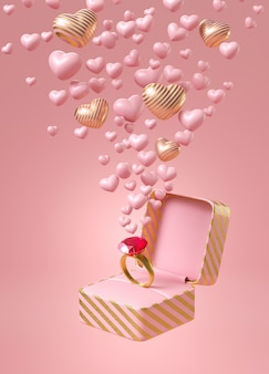 Anel rosa e ouro em caixa de jóias com listras rosa e ouro com pequenas corações