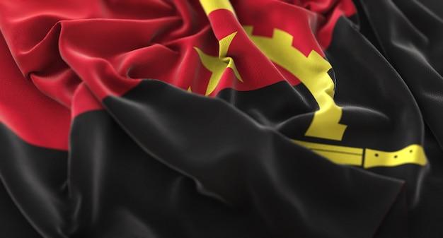 Angola flag ruffled beautifully waving macro close-up shot