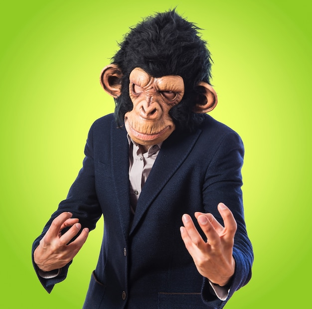 Angry monkey man on colorful background