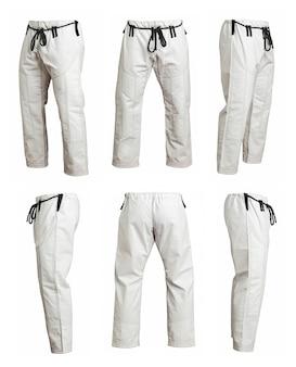 Ângulo diferente de calças de quimono esportivo para treinamento, isolado no fundo branco