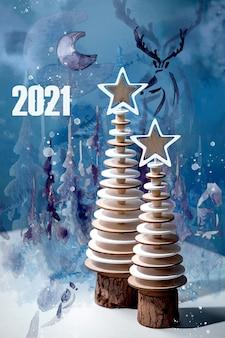 Ano novo 2021 design moderno decoração de natal pinheiros de madeira e elementos criativos em aquarela sobre azul.