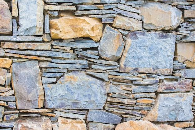 Antecedentes de alvenaria. parede de diferentes tipos de pedra