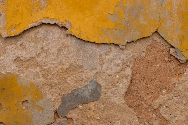 Antiga muralha de textura amarela