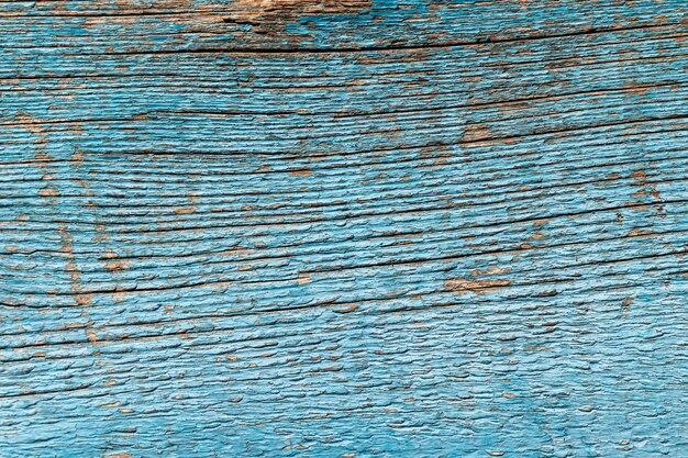 Antigo fundo de madeira desgastado com tinta azul rachada