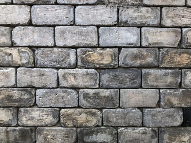 Antigo fundo de parede de tijolo com a luz do dia