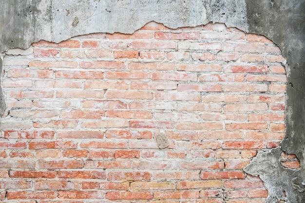 Antigo fundo de parede de tijolo vintage de concreto rachado, plano de fundo texturizado, padrão de parede de tijolo antigo, para plano de fundo