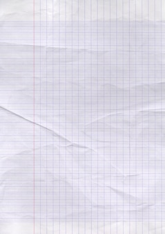 Antigo fundo de textura de folha de papel alinhado gasto.