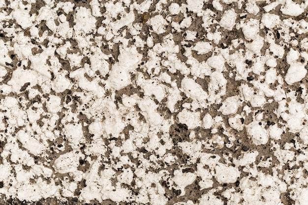 Antigo fundo de textura de parede de pedra cinza de fachada