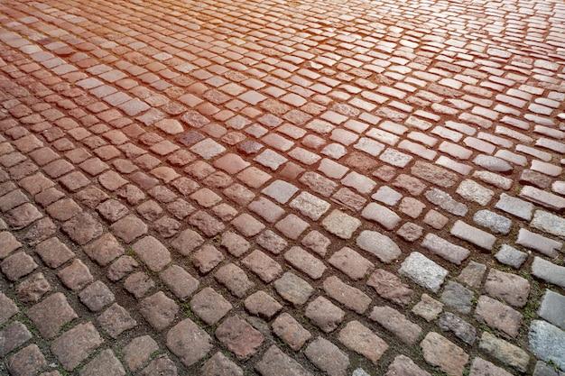 Antigo padrão de pedras de pavimentação