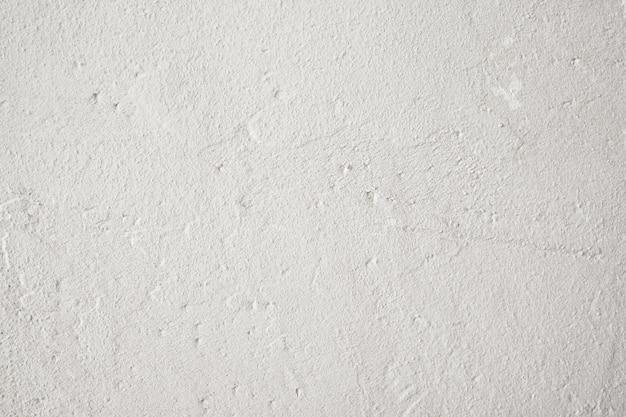 Antigo pano de fundo de parede branca irregular