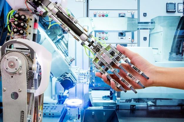 Aperto de mão de inteligência artificial com humanos