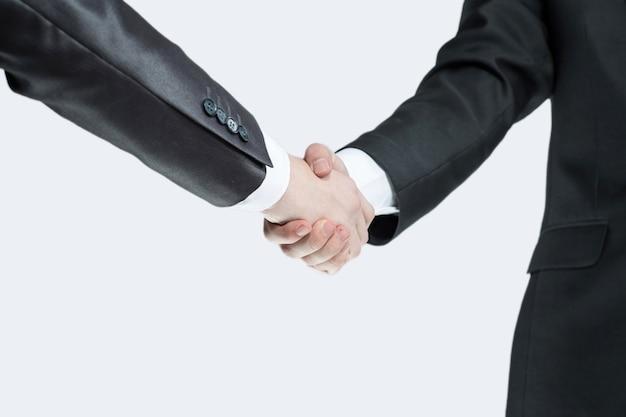 Aperto de mão empresários o conceito de cooperação