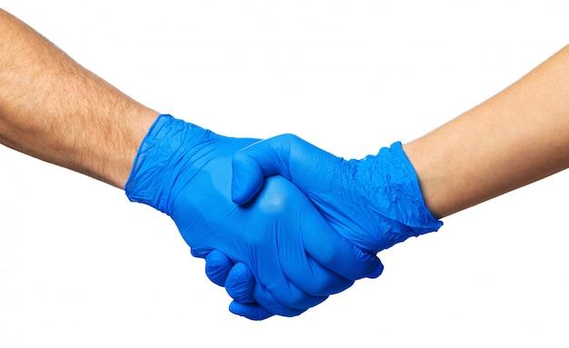 Aperto de mão no luvas azuis, conceito de ajuda. higiene pessoal durante uma pandemia