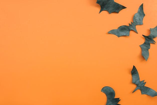 Aplicação de halloween nas cores preto e laranja com morcegos