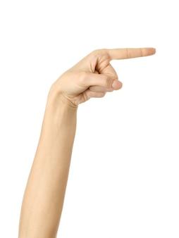 Apontando para a direita. mão de mulher gesticulando isolado no branco