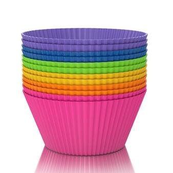 Aposta de copos de silicone cupcake coloridos em um fundo branco. renderização 3d