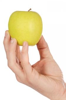 Apple em uma mão baixa em calorias um fundo branco