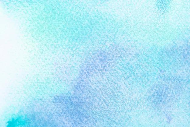Aquarela azul abstrata sobre fundo branco. os salpicos de cor no papel. é uma mão desenhada.
