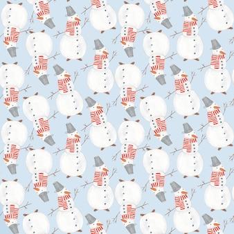 Aquarela fofa sem costura padrão de natal com bonecos de neve engraçados sobre fundo azul macio