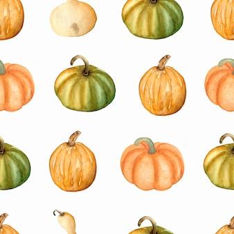 Aquarela sem costura padrão com abóboras em cores verdes, amarelas e laranja. dia de ação de graças. outono
