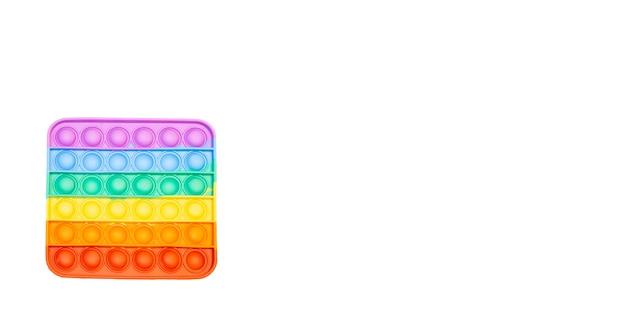 Arco-íris anti-stress pop it fidget no fundo branco jogo sensorial de covinha simples para criança