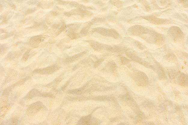 Areia da praia fina no sol do verão