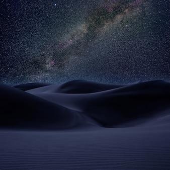 Areia das dunas do deserto na noite das estrelas da maneira leitosa