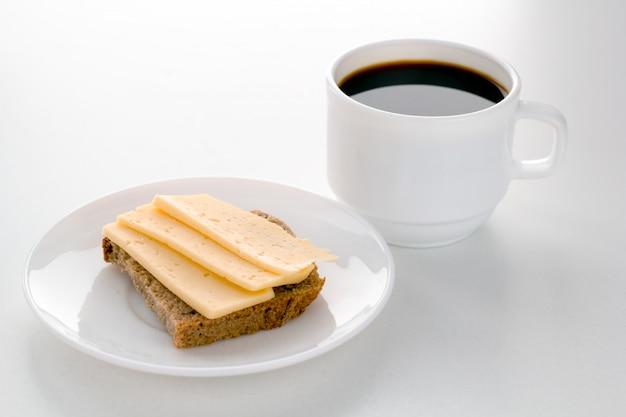 Areia do copo e do queijo de café para o café da manhã