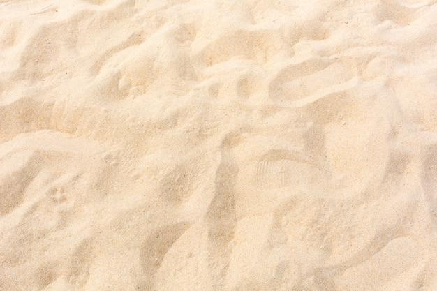 Areia natureza na praia como pano de fundo