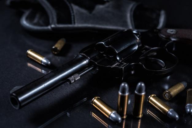 Arma com fundo preto