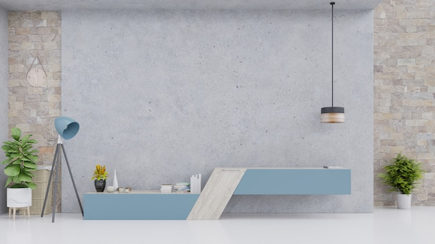 Armário azul na sala vazia moderna com muro de cimento e assoalho.