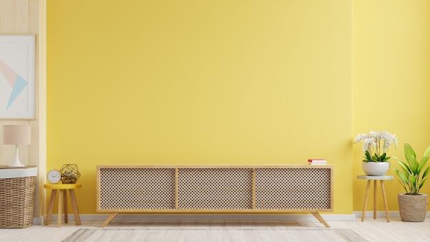 Armário de tv em uma sala de estar moderna com abajur, mesa, flores e plantas na parede amarela, renderização em 3d