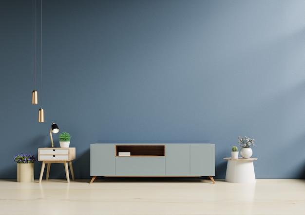 Armário de tv em uma sala moderna e vazia, atrás de uma parede azul escura