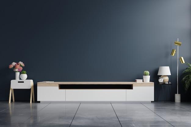 Armário de tv em uma sala vazia moderna com parede azul escura atrás