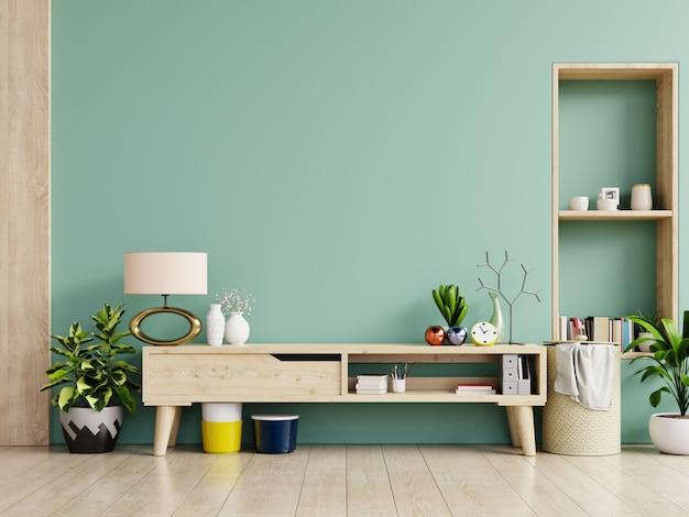 Armário para tv / armário em uma sala, paredes verdes.